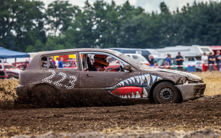 LINSBURG  GERMANY - AUGUST 05, 2017: Stockcar drives on a dirty track at a Stockcar challenge. Editorial