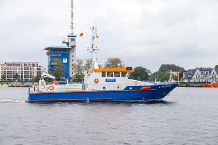 Warnemuende   Germany - August 12, 2017: german police ship drives at public event hanse sail in warnemuende, germany.