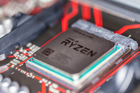 HANNOVER  GERMANY - OCTOBER 12, 2017: AMD Ryzen processor chip on an Asus prime 350 plus mainboard. Editorial