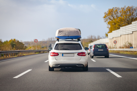 white car with porter drives on a german motorway Stock fotó