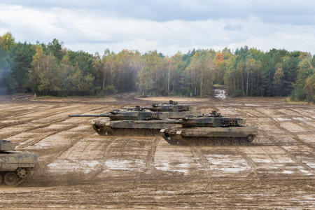german main battle tanks drives on battlefield
