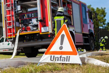German Unfall ( accident ) sign near a fire truck