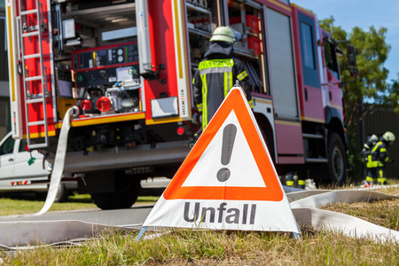 German Unfall ( accident ) sign near a fire truck