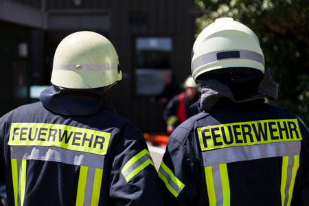 German fireman ( Feuerwehr ) stands near an accident Standard-Bild