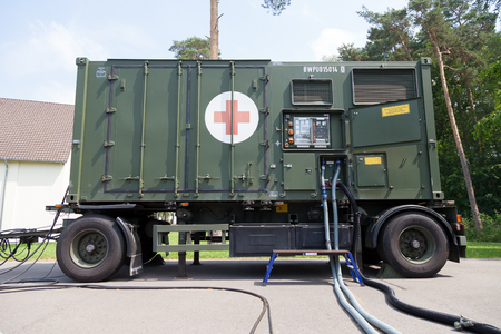 BURG  GERMANY - JUNE 25, 2016: german military rescue station generator trailer stands on platform at open day in barrack burg