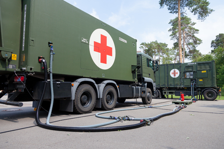 BURG  GERMANY - JUNE 25, 2016: german military rescue station truck stands on platform at open day in barrack burg