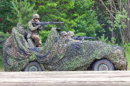 BURG / GERMANY - JUNE 25, 2016: german soldiers on mercedes benz wolf, at open day in barrack burg