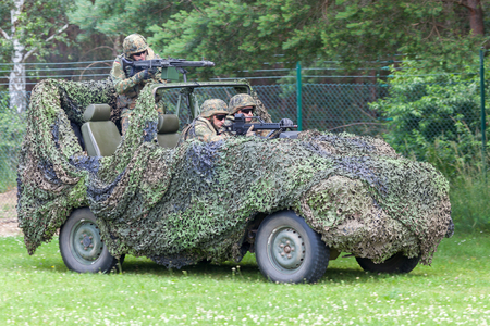 BURG  GERMANY - JUNE 25, 2016: german soldiers on mercedes benz wolf, at open day in barrack burg