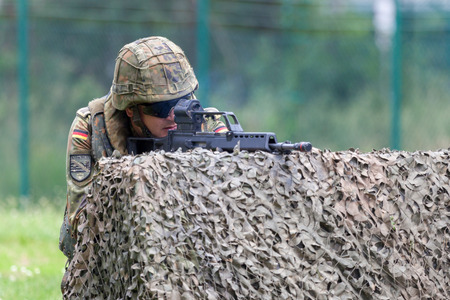 BURG  GERMANY - JUNE 25, 2016: german soldier with hk g 36 rifle on assault course , at open day in barrack burg