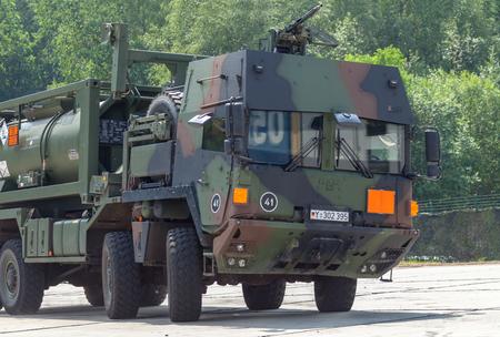 BURG / GERMANY - JUNE 25, 2016: german military MAN Multi 2 swap body truck tanker at open day in barrack burg Editorial