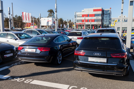FUERTH  GERMANY - FEBRUARY 25, 2018: Audi emblem on an audi car. Audi AG is a German automobile manufacturer that designs, engineers, produces, markets and distributes luxury vehicles.