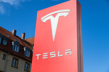 FUERTH / GERMANY - MARCH 4, 2018: Tesla logo near a car dealer. Tesla, Inc. is an American company that specializes in electric automotives, energy storage and solar panel manufacturing. Editorial