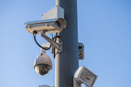 monitoring cameras hangs on a lamp pole