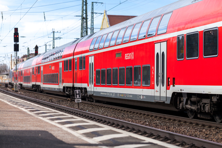 FUERTH  GERMANY - MARCH 11, 2018: RE Regional Express train from Deutsche Bahn passes train station fuerth in germany.
