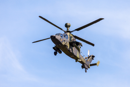BERLIN  GERMANY - APRIL 28, 2018: Military twin-engined attack helicopter Tiger, from Airbus Helicopters flies at airport Berlin  Schoenefeld.