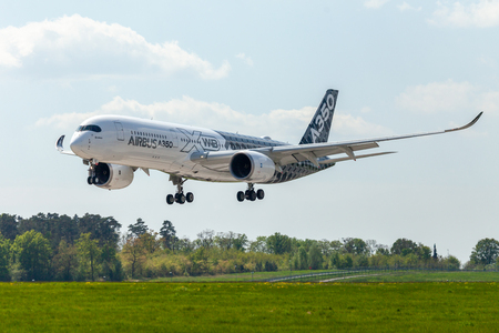 BERLIN / GERMANY - APRIL 28, 2018:  Airbus A350 XWB plane flies at airport Berlin / Schoenefeld. The Airbus A350 XWB is a family of long-range, twin-engine wide-body jet airliners. Redakční