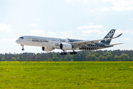BERLIN  GERMANY - APRIL 28, 2018:  Airbus A350 XWB plane flies at airport Berlin  Schoenefeld. The Airbus A350 XWB is a family of long-range, twin-engine wide-body jet airliners.