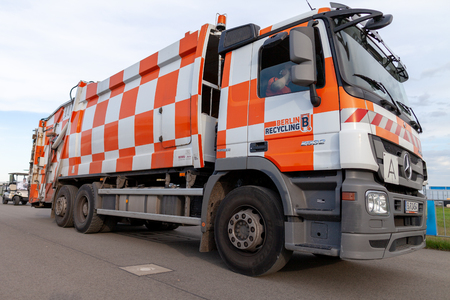 BERLIN / GERMANY - APRIL 28, 2018: German garbage truck from Berlin Recycling drives on airfield Schoenefeld.