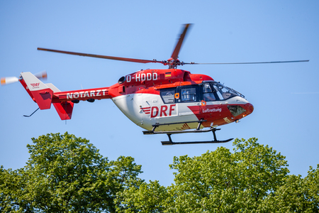 DELMENHORST  GERMANY - MAY 06, 2018: Eurocopter BK-117 from DRF Luftrettung flies over landing side. Notarzt means emergency doctor.