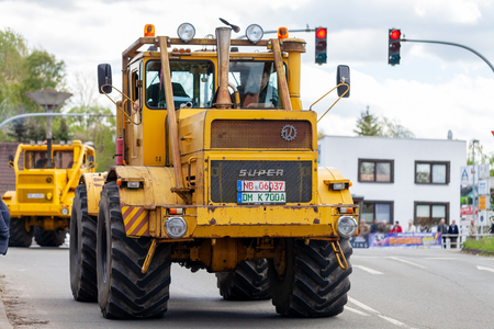 ALTENTREPTOW MECKLENBURG- WEST POMERANIA - MAY 1, 2018: Russian Kirowez K 700 tractor drives on street at an oldtimer show Reklamní fotografie - 104404677