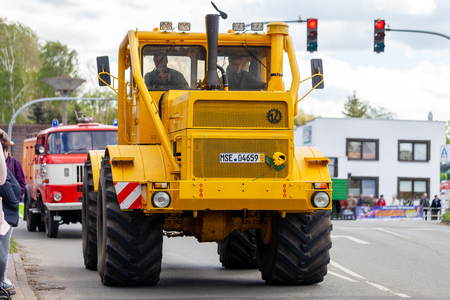 ALTENTREPTOW MECKLENBURG- WEST POMERANIA - MAY 1, 2018: Russian Kirowez K 700A tractor drives on street at an oldtimer show