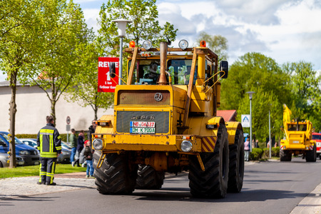 ALTENTREPTOW MECKLENBURG- WEST POMERANIA - MAY 1, 2018: Russian Kirowez K 700 tractor drives on street at an oldtimer show Reklamní fotografie - 104404691