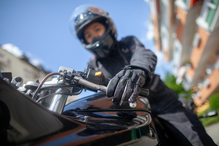 Woman with a black helmet on a motorbike Stockfoto