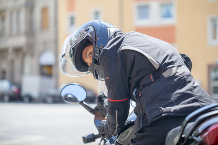 Woman with a black helmet on a motorbike Stock Photo