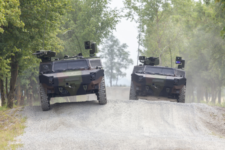 German light armoured  reconnaissance vehicle drives on a road Archivio Fotografico