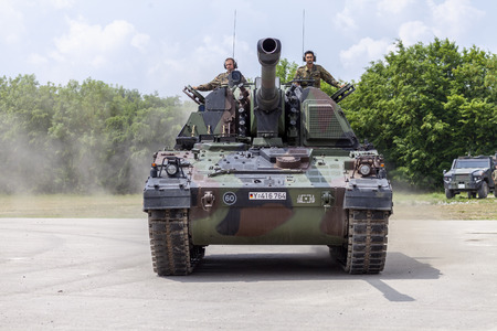FELDKIRCHEN  GERMANY - JUNE 9, 2018: German Panzerhaubitze 2000, artillery tank drives on a road on Day of the Bundeswehr in Feldkirchen  Germany.