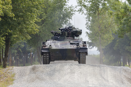German infantry fighting vehicle drives on a road 스톡 콘텐츠