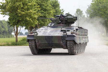 German infantry fighting vehicle drives on a road Archivio Fotografico