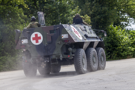FELDKIRCHEN  GERMANY - JUNE 9, 2018: German armoured personnel carrier Fuchs, medical version drives on a road at Day of the Bundeswehr in Feldkirchen  Germany. 報道画像