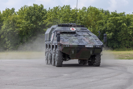FELDKIRCHEN  GERMANY - JUNE 9, 2018: German armoured medical carrier Boxer, from Bundeswehr, drives on a road at Day of the Bundeswehr in Feldkirchen  Germany.