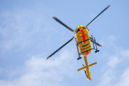 FELDKIRCHEN  GERMANY - JUNE 09, 2018: Eurocopter EC-135 from ADAC Luftrettung flies over landing side. Notarzt means emergency doctor.