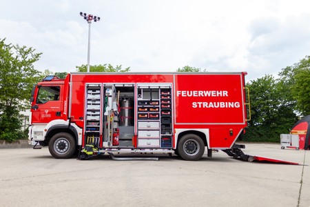 FELDKIRCHEN  Germany - JUNE 9, 2018: German fire engine stands on a platform on open day. The german word Feuerwehr means fire department.