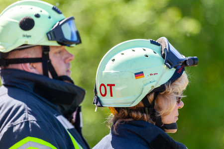 DELMENHORST / GERMANY - MAY 6, 2018: Two german firefighters shows to an accident. Feuerwehr means german fire department. Editoriali