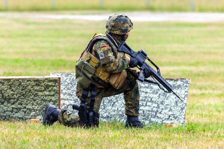 FELDKIRCHEN / GERMANY - JUNE 9, 2018: German soldier on an exercise at open day on day of the Bundeswehr in Feldkirchen