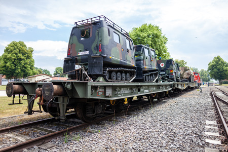 FELDKIRCHEN / GERMANY - JUNE 9, 2018: German armoured military vehicles from Bundeswehr, stands on a train waggon at Day of the Bundeswehr in Feldkirchen / Germany. Editorial