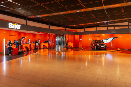 HAMBURG  GERMANY - SEPTEMBER 28, 2018: Sixt branch store on Airport Hamburg. Sixt is a European multinational car rental company with about 4,000 locations in over 105 countries.
