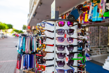 ALANYA / TURKEY - SEPTEMBER 30, 2018: Sunglasses from Ray-Ban hangs on a stand at a local market in Alanya. Editorial