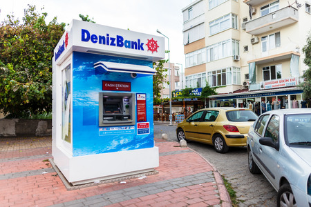 ALANYA / TURKEY - SEPTEMBER 29, 2018: Cash dispenser from DenizBank stands near a street in Alanya Editorial