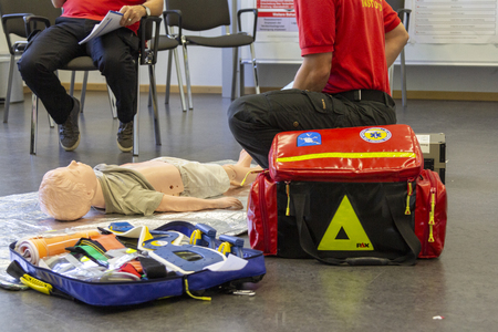 MUNICH  GERMANY - SEPTEMBER 05, 2018: Medical training for german ambulance man on a puppet. PHTLS Instruktor instructs new medical methods for rescue service staff. Editorial