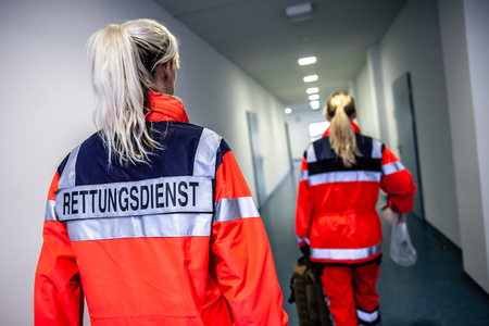 German paramedic runs in a floor to an accident. The german word RETTUNGSDIENST means emergency service