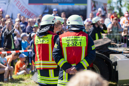 DELMENHORST / GERMANY - MAY 6, 2018: German firefighters  train on a truck accident at an open day. Feuerwehr means german fire department. Editoriali