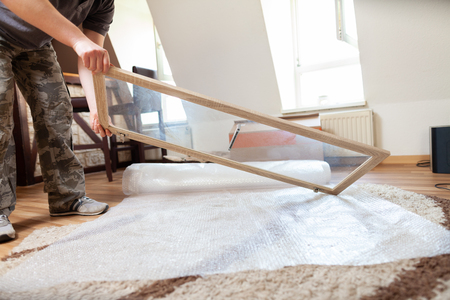 Packed household stuff for moving into a new house Standard-Bild - 119891936