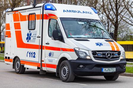 MUNICH / GERMANY - APRIL 14, 2019: A german Ambulance from Aicher Ambulance Union drives on a street in Munich. Redactioneel