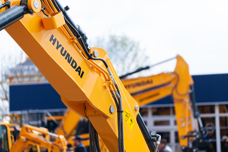 MUNICH  GERMANY - APRIL 14, 2019: Hyundai logo on a digger arm at a Hyundai machine dealer.