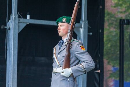 AUGUSTDORF  GERMANY - JUNE 15, 2019: German soldier from the guard battalion walks on a stage at Day of the Bundeswehr 2019.