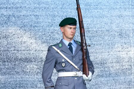 AUGUSTDORF / GERMANY - JUNE 15, 2019: German soldier from the guard battalion walks on a stage at Day of the Bundeswehr 2019. Editorial